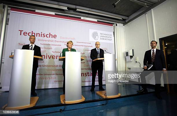 German Chancellor Angela Merkel Economy Minister Rainer Bruederle and Enviroment Minister Norbert Roettgen accompanied by German government spokesman...