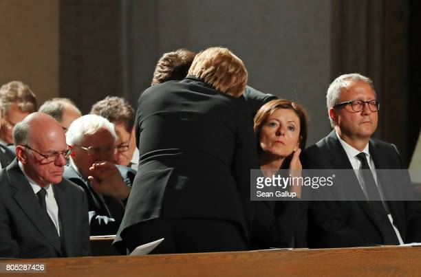 German Chancellor Angela Merkel embraces a guest prior to a requiem for former German Chancellor Helmut Kohl at the Speyer cathedral on July 1, 2017...