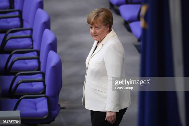German Chancellor Angela Merkel emerges moments after she took her oath to serve her fourth term as chancellor following her election by the...