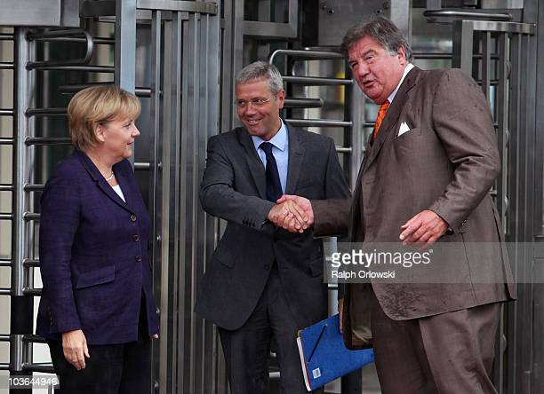 German Chancellor Angela Merkel Environment Minister Norbert Roettgen and Juergen Grossmann CEO of German energy giant RWE arrive at the Emsland...
