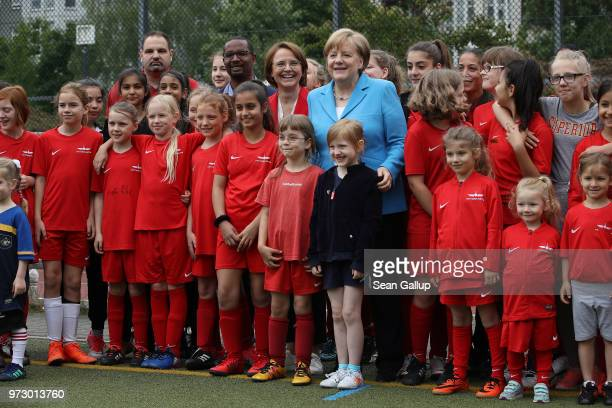 German Chancellor Angela Merkel Federal Commissioner for Migration Refugees and Integration Annette WidmannMauz and former football star Cacau pose...