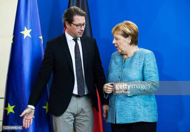 German Chancellor Angela Merkel Federal Minister for Transport and Digital Infrastructure Andreas Scheuer arrive to a press conference to hand over...