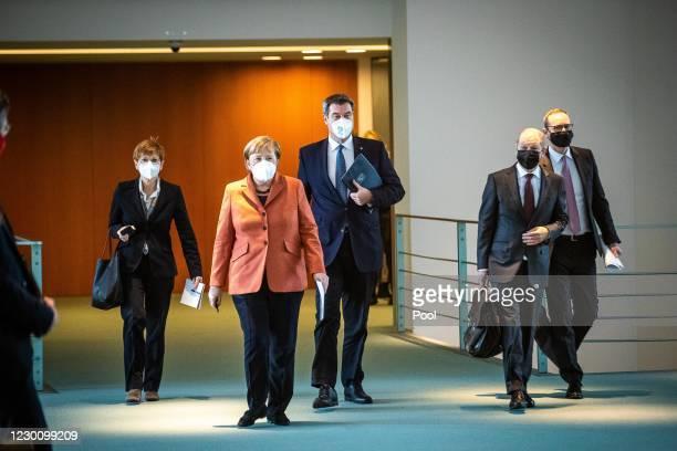 German Chancellor Angela Merkel, Finance Minister Olaf Scholz, Bavarian Governor Markus Soeder, Berlin Mayor Michael Mueller arrive to speak to the...