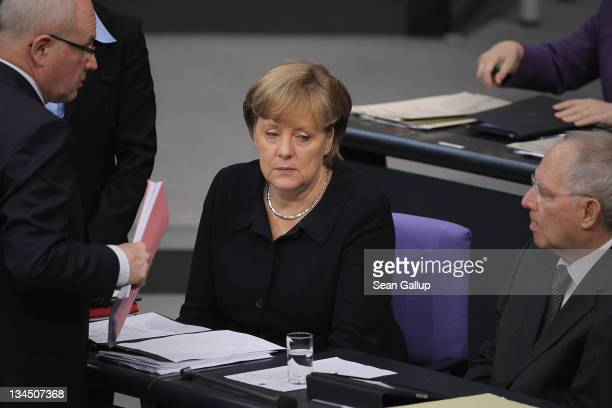 German Chancellor Angela Merkel Finance Minister Wolfgang Schaeuble and Volker Kauder head of the Bundestag faction of the German Christian Democrats...