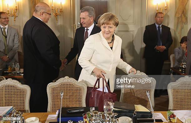 German Chancellor Angela Merkel followed by European Commissioner for Digital Economy and Society Guenther Oettinger arrives for a meeting of the...