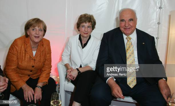 German Chancellor Angela Merkel former German Chancellor Helmut Kohl with friend Maike Richter attend the BILD and BAMS summer reception on July 4...