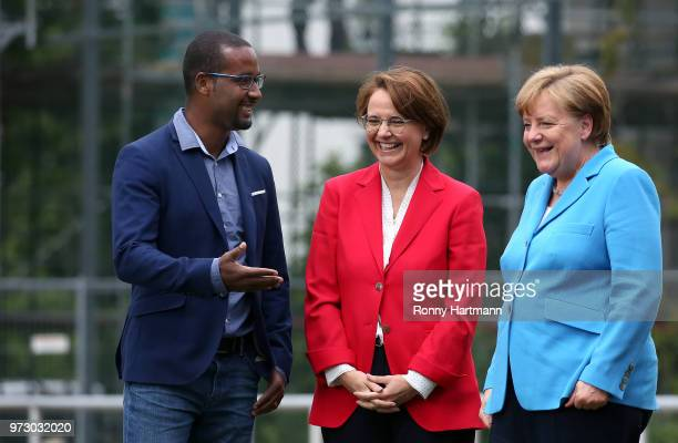 German Chancellor Angela Merkel former German National player Cacau and Federal Commissioner for Migration Refugees and Integration Annette...