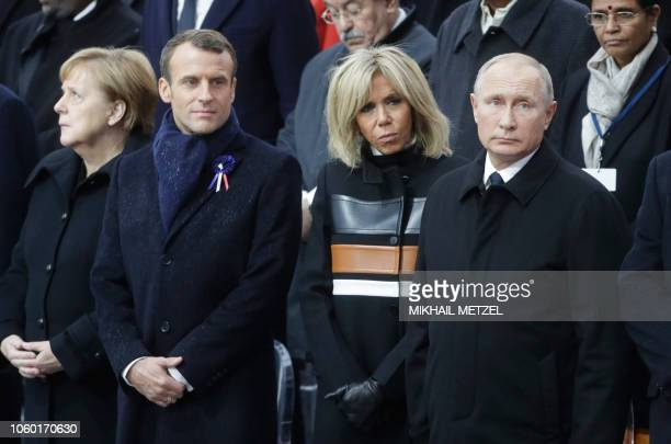 German Chancellor Angela Merkel French President Emmanuel Macron and his wife Brigitte Macron and Russian President Vladimir Putin attend a ceremony...