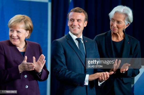 German Chancellor Angela Merkel, French President Emmanuel Macron and incoming President of the European Central Bank Christine Lagarde attend a...