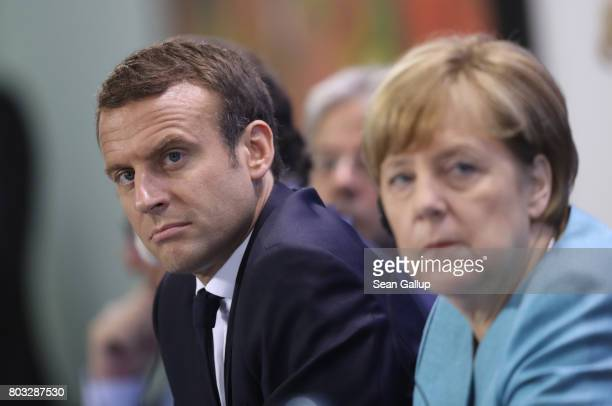 German Chancellor Angela Merkel French President Emmanuel Macron and other EU leaders speak to the media following a meeting of European Union...