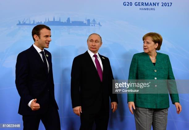 German Chancellor Angela Merkel French President Emmanuel Macron and Russia's President Vladimir Putin pose for a picture prior to a meeting during...