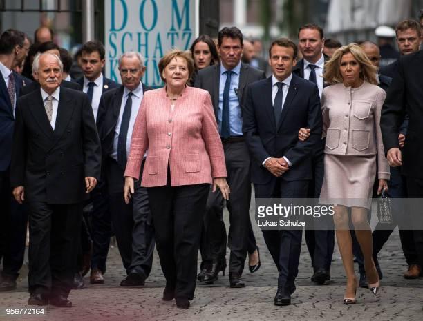 German Chancellor Angela Merkel French President Emmanuel Macron and his wife Brigitte MarieClaude Macron arrive for the International Charlemagne...