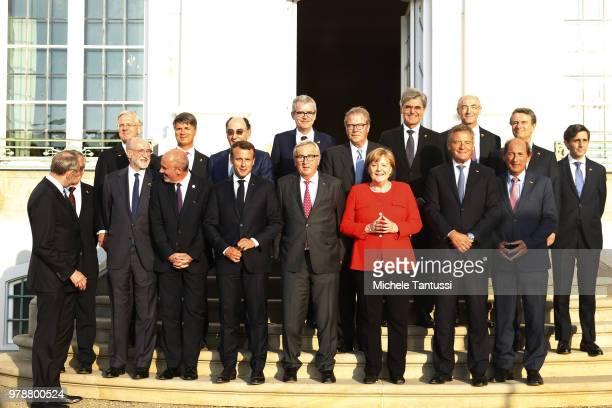 German Chancellor Angela Merkel French President Emmanuel Macron and EU commission president JeanClaude Juncker pose with representatives of German...