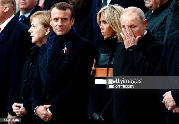 German Chancellor Angela Merkel French President Emmanuel Macron his wife Brigitte Macron and Russian President Vladimir Putin attend a ceremony at...
