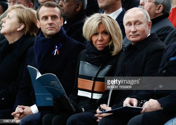 German Chancellor Angela Merkel French President Emmanuel Macron French President's wife Brigitte Macron and Russian President Vladimir Putin attend...