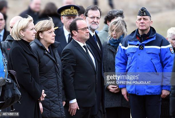 German Chancellor Angela Merkel French President Francois Hollande and Spanish Prime Minister Mariano Rajoy reflect on March 25 2015 in a field in...