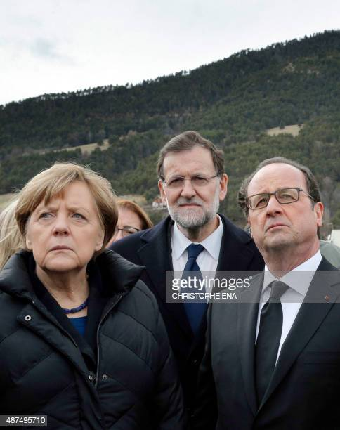 German Chancellor Angela Merkel , French President Francois Hollande and Spanish Prime Minister Mariano Rajoy pay their respect to the victims in...