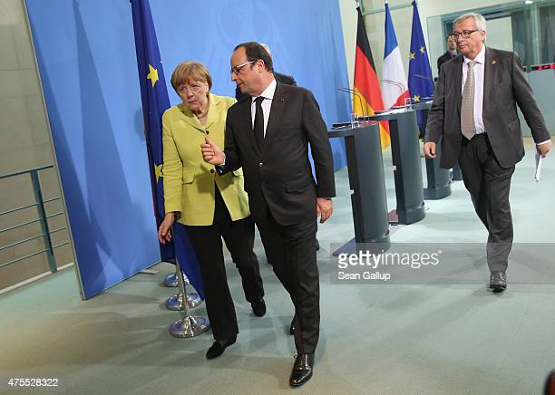 German Chancellor Angela Merkel French President Francois Hollande and European Union Commission President JeanClaude Juncker depart after giving...