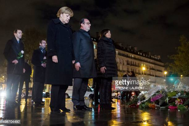 German Chancellor Angela Merkel French President Francois Hollande and Paris Mayor Anne Hidalgo pay their respects to the victims of the November 13...
