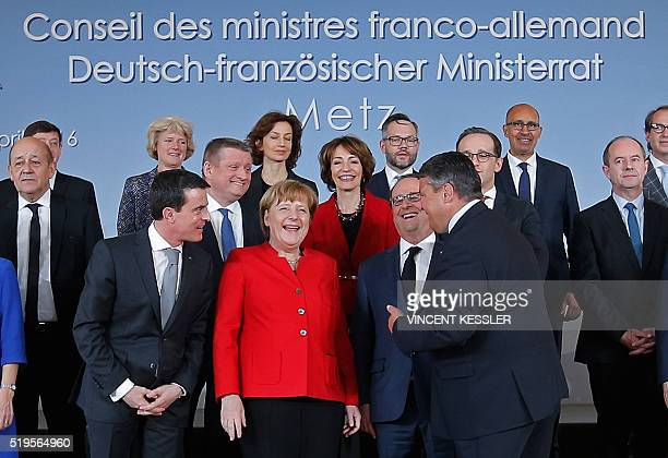 German Chancellor Angela Merkel French President Francois Hollande French Prime Minister Manuel Valls and German Vice Chancellor and Economy Minister...