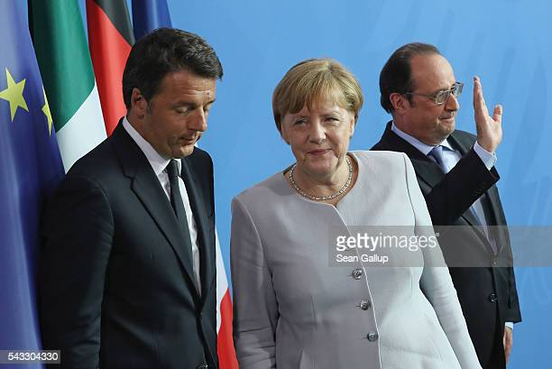 German Chancellor Angela Merkel French President Francois Hollande and Italian Prime Minister Matteo Renzi depart after speaking to the media during...