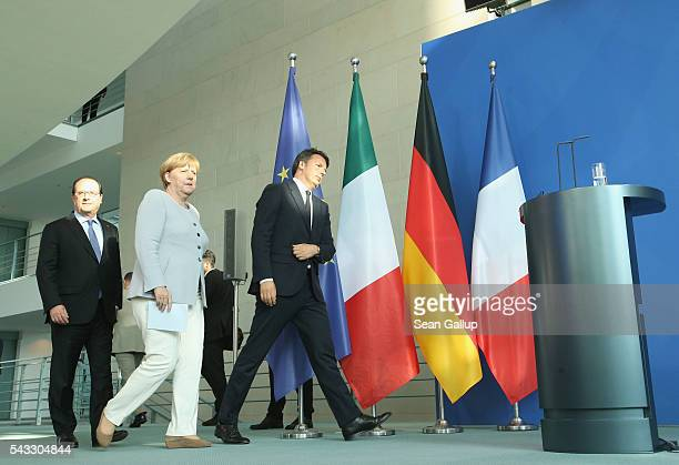 German Chancellor Angela Merkel French President Francois Hollande and Italian Prime Minister Matteo Renzi arrive to speak to the media during talks...