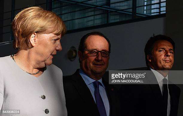 German Chancellor Angela Merkel French President Francois Hollande and Italy's Prime Minister Matteo Renzi arrive for a press conference ahead of...