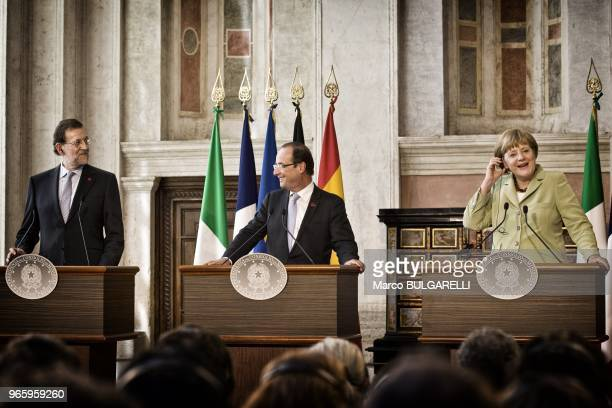 German Chancellor Angela Merkel French President Francois Hollande and Spanish Prime Minister Mariano Rajoy during the press conference after the...