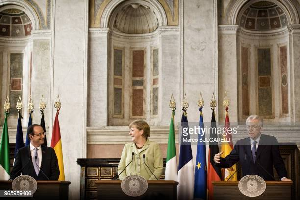 German Chancellor Angela Merkel French President Francois Hollande and Italian Prime Minister Mario Monti during the press conference after the...