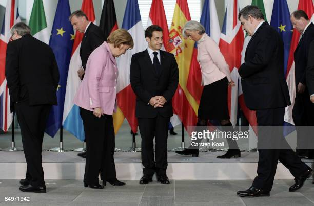 German Chancellor Angela Merkel French President Nicolas Sarkozy and British Prime Minister Gordon Brown come together for a family photo after a...