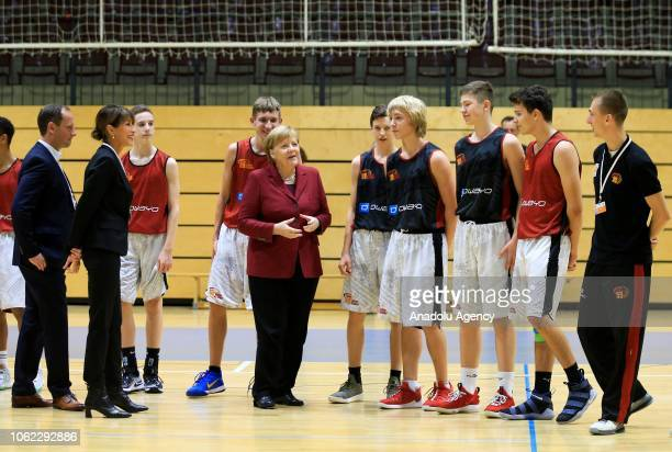 German Chancellor Angela Merkel gathers with Chemnitz 99 basketball team's players during her visit the Chemnitz city in Germany on November 16 2018...