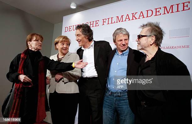 German Chancellor Angela Merkel German actors Angelica Domroese her husband Hilmar Thate Winfried Glatzeder and German film director Andreas Dresen...
