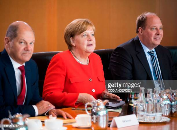 German Chancellor Angela Merkel German Finance Minister and ViceChancellor Olaf Scholz and Chief of Staff Helge Braun attend the weekly cabinet...