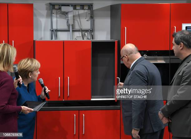 German Chancellor Angela Merkel German Minister for Economy Peter Altmaier and Bavaria's State Premier Markus Soeder check the cupboard of a kitchen...
