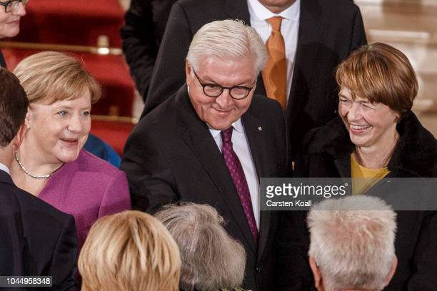 German Chancellor Angela Merkel German President FrankWalter Steinmeier and First Lady Elke Buedenbender arrive to a service at the Dom cathedral...
