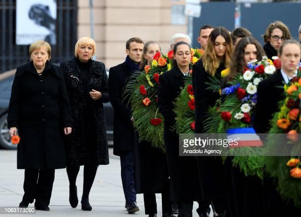 German Chancellor Angela Merkel German President FrankWalter Steinmeier French President Emmanuel Macron arrive for a wreath laying ceremony at the...