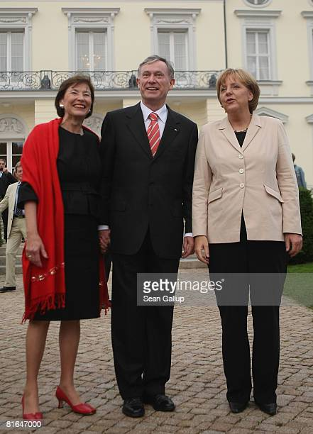 German Chancellor Angela Merkel German President Horst Koehler and his wife Eva Luise Koehler attend the annual summer party hosted by Koehler at...