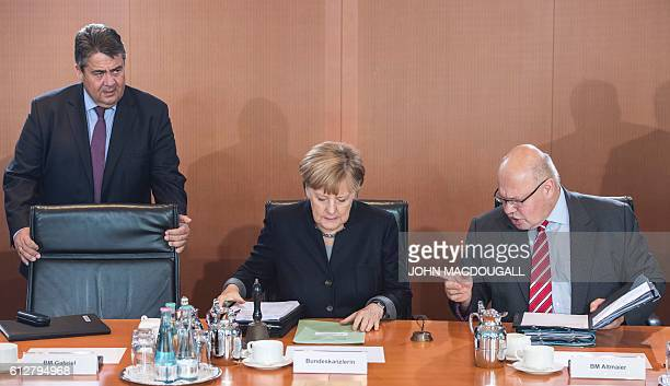German Chancellor Angela Merkel German Vice Chancellor Economy and Energy Minister Sigmar Gabriel and German Chief of Staff Peter Altmaier attend a...