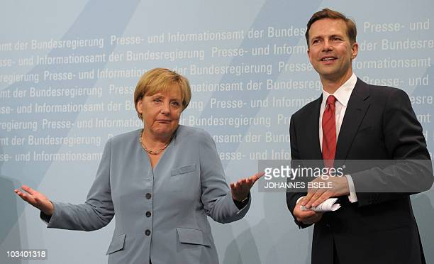 German Chancellor Angela Merkel gestures as she and the government's new spokesman Steffen Seibert address a press conference on August 16 2010 in...