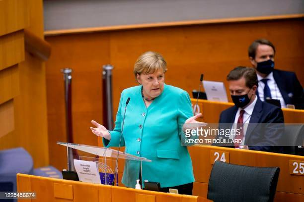 German Chancellor Angela Merkel gestures as she speaks during a plenary session at the European Parliament in Brussels on July 8, 2020 to present the...