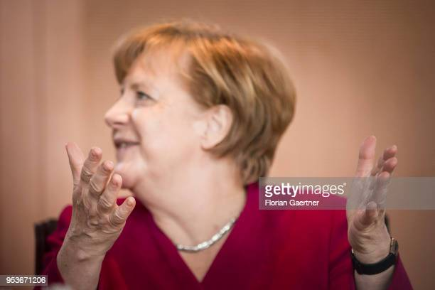 German Chancellor Angela Merkel gestures during the weekly cabinet meeting at the chancellery on May 02 2018 in Berlin Germany