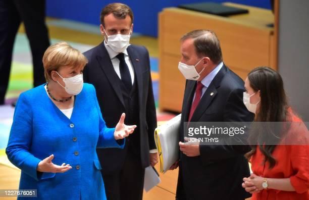 German Chancellor Angela Merkel gestures next to France's President Emmanuel Macron Sweden's Prime Minister Stefan Lofven and Finland's Prime...