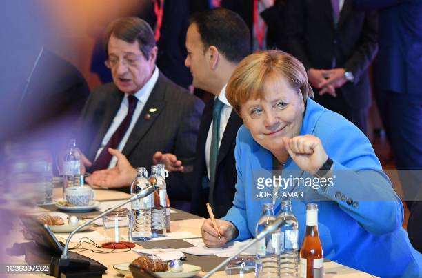 German Chancellor Angela Merkel gestures prior to the start of a plenary session at the Mozarteum University during the EU Informal Summit of Heads...