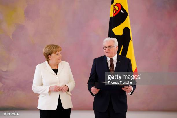 German Chancellor Angela Merkel gets her appointment certificate from German President FrankWalter Steinmeier after her election by the Bundestag for...