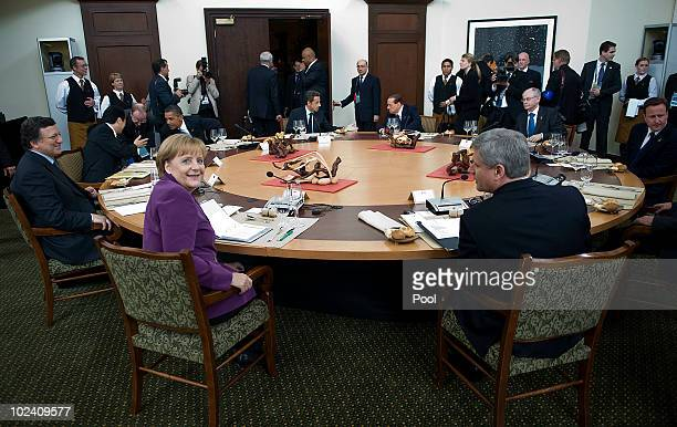 German Chancellor Angela Merkel gets together with Jose Manuel Barroso president of the European Commission Naoto Kan Japan's prime minister and...