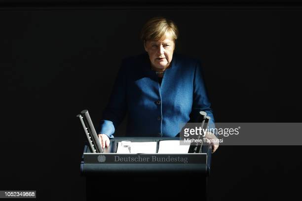 German Chancellor Angela Merkel gives a government declaration at the Bundestag prior to today's summit of European leaders at the European Council...