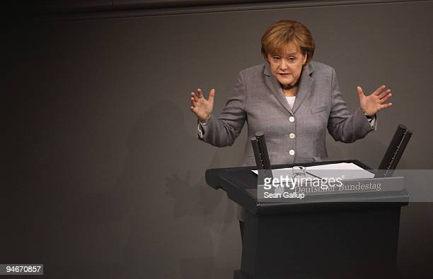German Chancellor Angela Merkel gives a government declaration on the Copenhagen climate summit at the Reichstag the seat of the German Parliament on...