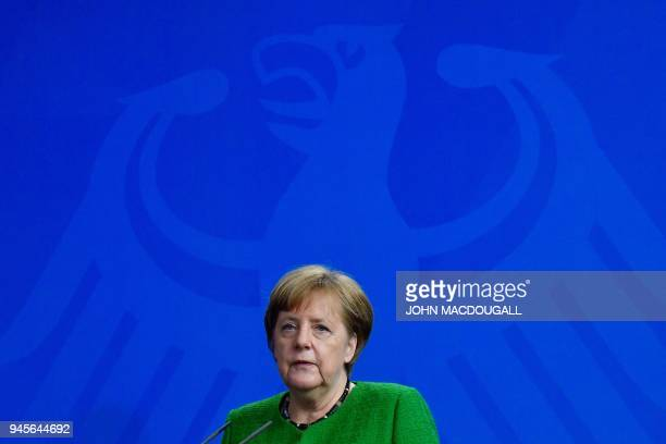German Chancellor Angela Merkel gives a joint press conference with the Serbian President on April 13 2018 at the Chancellery in Berlin / AFP PHOTO /...