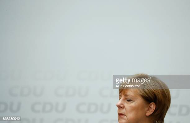 German Chancellor Angela Merkel gives a press conference at the headquarters of the Christian Democratic Union party in Berlin on September 25 one...