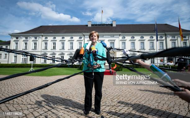 """German Chancellor Angela Merkel gives a press statement during a """"coffee table"""" hosted by the German President to celebrate the 70th anniversary of..."""